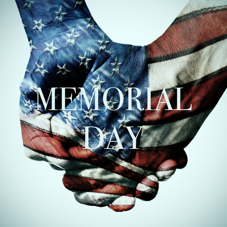 closeup of two people holding hands patterned with the flag of the United States and the text memorial day against an off-white background