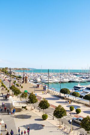 CAMBRILS, SPAIN - JANUARY 26, 2020: Aerial view over the port and the waterfront of Cambrils, in the famous Costa Daurada coast, Spain Редакционное