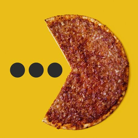 a bolognese pizza, made with ground beef, onion, tomato sauce, mozzarella and barbecue sauce, missing a piece, as it was a mouth and it was eating some dots on an orange background