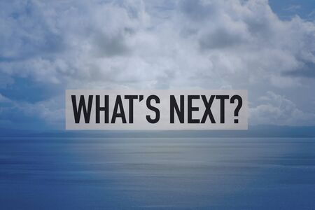 a view over a calm sea and a cloudy sky, after the storm, and the question what is next? in the foreground