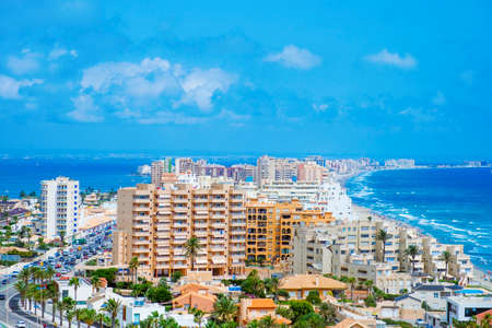 a panoramic view over La Manga del Mar Menor, in Murcia, Spain, with the Mar Menor lagoon on the left and the Mediterranean sea on the right