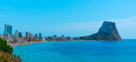 a view over Calp, in the Valencian Community, Spain, highlighting the apartment towers and the Penon de Ifac promontory on the right, in a panoramic format to use as web banner or header Banque d'images