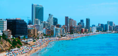 CALPE, SPAIN - AUGUST 2, 2021: A panoramic view over the main beach of Calpe, an important summer tourist destination in Spain, highlighting its characteristic apartment towers Éditoriale