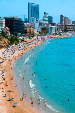 CALPE, SPAIN - AUGUST 2, 2021: A panoramic view over the main beach of Calpe, in Valencia, highlighting its characteristic apartment towers. It is an important summer tourist destination in Spain Éditoriale