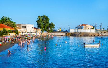 MAZARRON, SPAIN - JULY 27, 2021: Some people enjoying in the Bahia beach, also known as Reya beach, in Puerto de Mazarron, Mazarron, in the Costa Calida coast of the Region of Murcia, Spain