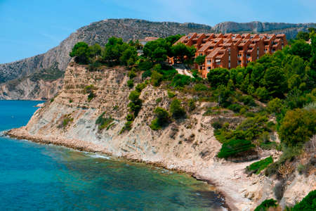 a panoramic view over the Cala La Manzanera beach in Calpe, in the Valencian Community, Spain