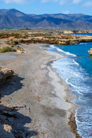 a view of La Galera beach, in Aguilas, in the Costa Calida coast, Region of Murcia, Spain, highlighting the Calnegre mountain range in the background