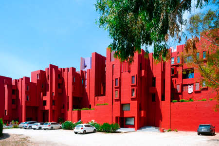 Calpe, Spain - August 2, 2021: A view of the picturesque La Muralla Roja building, in Calpe, Spain, an apartment building designed by Ricardo Bofill and built in 1972