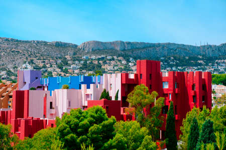 Calpe, Spain - August 2, 2021: A view of the picturesque and colorful La Muralla Roja building, in Calpe, Spain, an apartment building designed by Ricardo Bofill and built in 1972