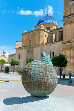 Elche, Spain - July 26, 2021: A lateral view of the Basilica of Santa Maria church, dedicated to the Virgin Mary, and the Palau Square in Elche, Spain