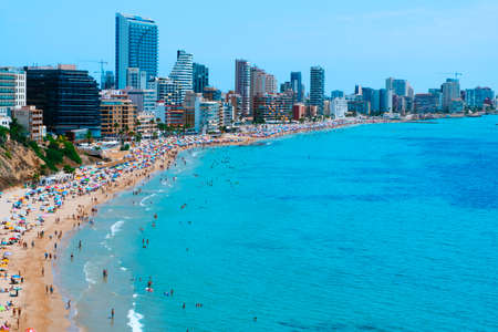 Calpe, Spain - August 2, 2021: A panoramic view of the main beach of Calpe, Valencia, an important summer tourist destination in Spain, highlighting its characteristic apartment towers
