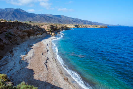 a view over Playa Larga beach, in Lorca, in the Costa Calida coast, Region of Murcia, Spain, with the Calnegre mountain range in the background Banque d'images