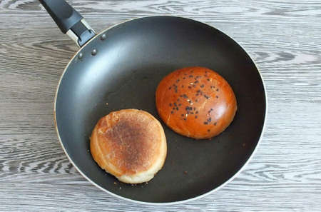 3. Grease a frying pan with vegetable oil, heat it up. Dry the cut portion of the rolls.