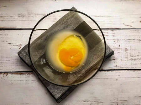 Add the egg to the container and mix well.