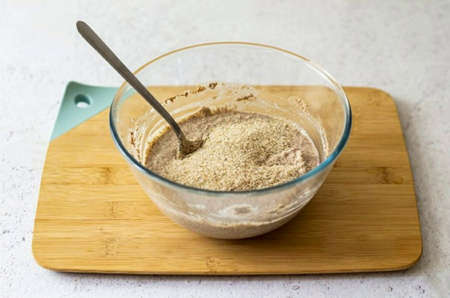 Finally add psyllium, stir and let the dough stand for 10-15 minutes. If the dough remains runny, add more psyllium.