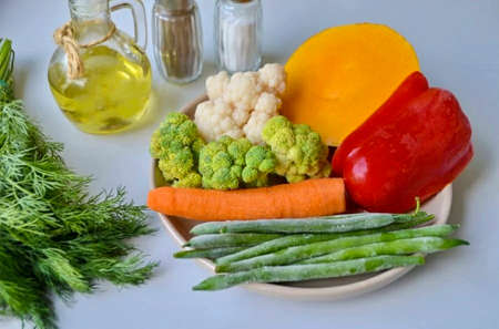 Prepare vegetables, oil, salt and pepper. Let's get started! Wash and peel vegetables. Frozen vegetables do not need to be thawed!