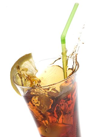 glass of cola with lemon and straw on white background Stock Photo - 4870538