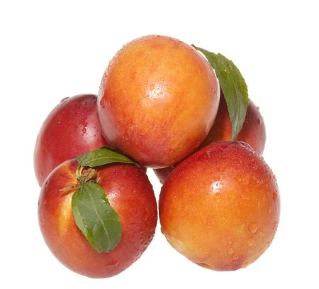 breackfast: Nectarines with leafs on white bacground Stock Photo
