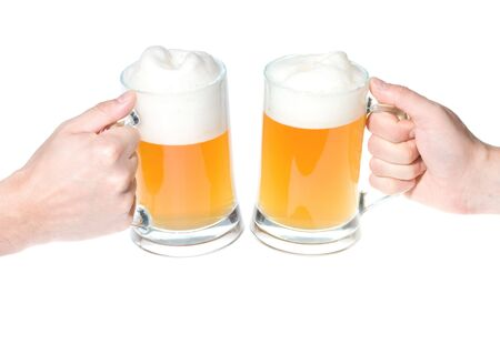 brewage: hands with mug of beer cheers isolated on white