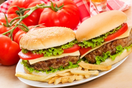 hamburgers with fries and vegetables