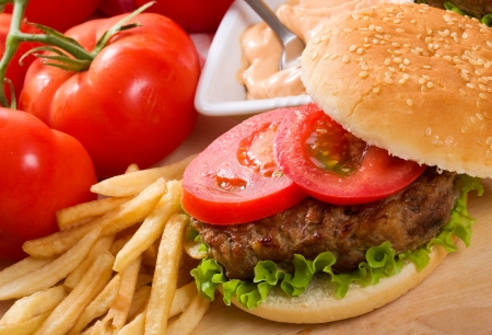 fries: hamburger with fries and vegetables Stock Photo