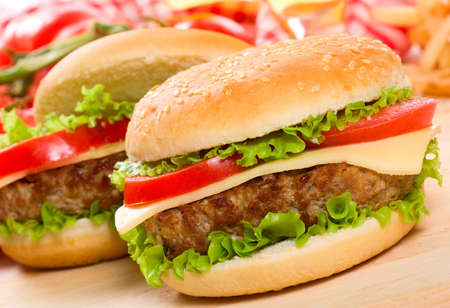 hamburgers with fries and vegetables photo
