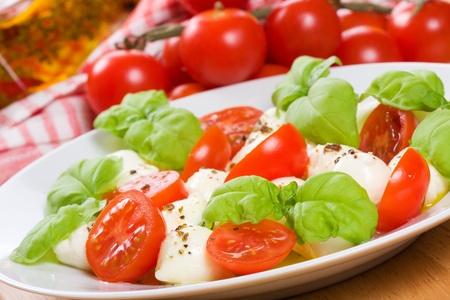 caprese salad: salad with mozzarella, basil and tomatoes