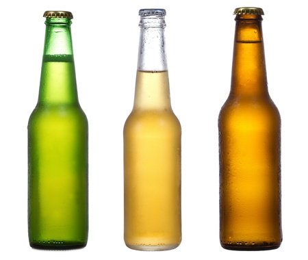 beer bubbles: different bottles of beer on a white background