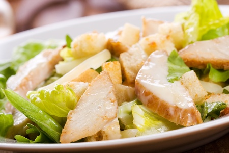 chicken caesar salad: Caesar salad with chicken and greens