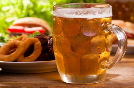 cold mug of beer with different snack Stock Photo - 10746522