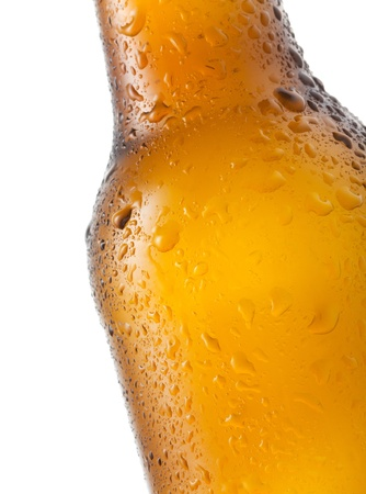 Bottle of beer with water drops on white background photo