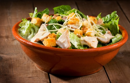 caesar salad: Caesar salad with chicken and greens
