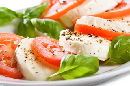 salad with mozzarella, tomatoes and basil Stockfoto