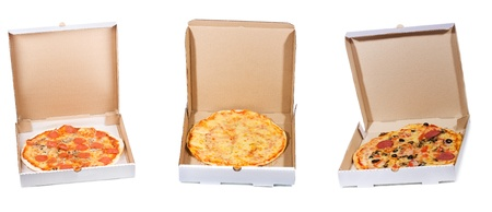 set with different pizza in open paper box on white background  photo