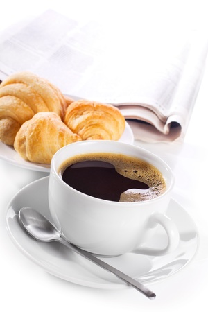 cup of black coffee, croissants and newspaper