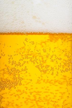beer foam: mug of beer as background
