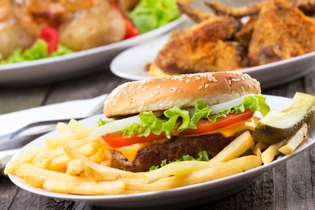 hamburger with fries and vegetables Stock Photo
