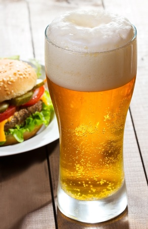 cold beer: glass of beer with hamburger