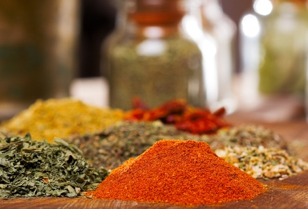 spice market: different spices on wooden table Stock Photo