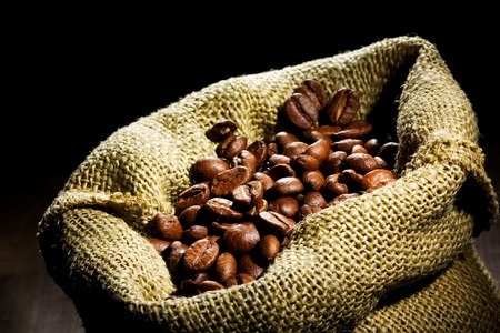 coffee sack: Coffee beans in canvas sack  Stock Photo