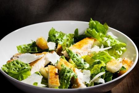 CHICKEN CAESAR SALAD: Caesar salad with chicken and greens