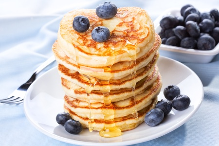 pancakes: stack of pancakes with syrup and blueberry