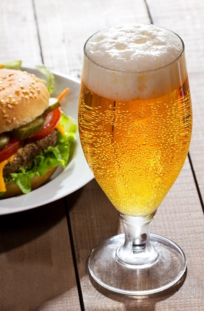 pub food: glass of beer with hamburger