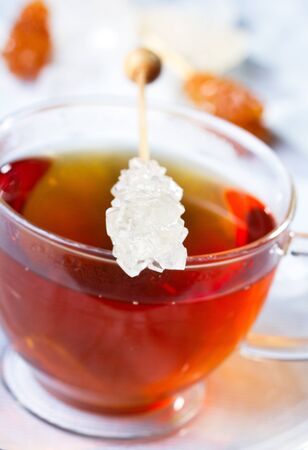 Cup of tea with sugar stick Stock Photo - 13423459