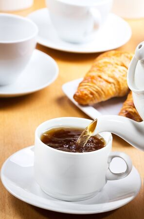 Pouring tea into cup of tea Stock Photo - 13423393