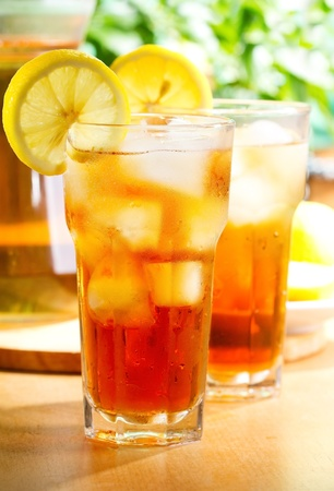 glass of ice tea with lemon photo