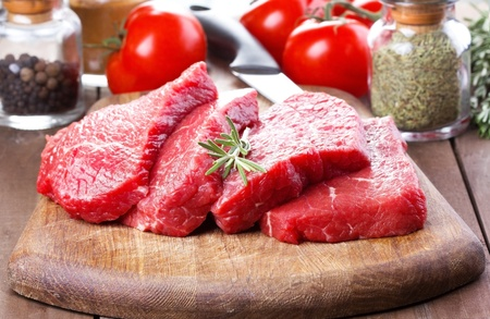 raw meat with rosemary and vegetables Stock Photo