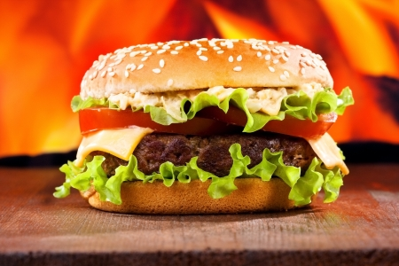 beef burger: hamburger on fire background Stock Photo