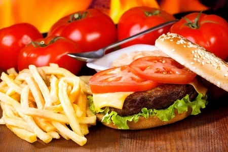 burger and fries: hamburger with fries and vegetables Stock Photo