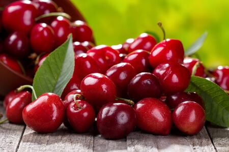 fresh food: fresh cherries on wooden table Stock Photo